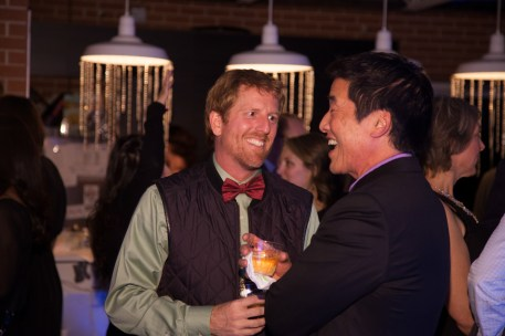 candid men chatting and laughing at holiday party, corporate holiday party, corporate event, denver holiday party photographer, event holiday photographer