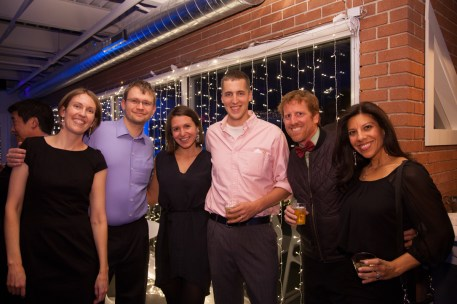 group enjoying holiday party smiling for photographer, corporate holiday party, corporate event, denver holiday party photographer, event holiday photographer