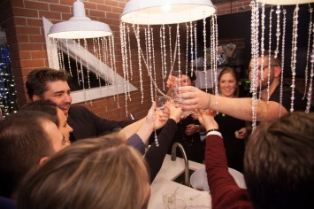 Why hire a photographer for your Salt Lake City holiday party? , group photo at holiday party, corporate holiday party, corporate event, denver holiday party photographer, event holiday photographer, cheers at holiday party