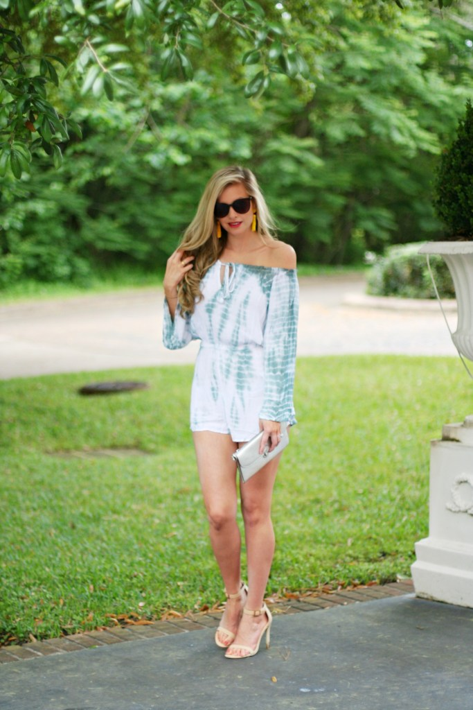 Lifestyle blogger Kinsey Walsh with off the shoulder tie dye romper and yellow tassel earrings