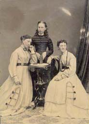 Tintype of three women, two of whom appear to be twins.