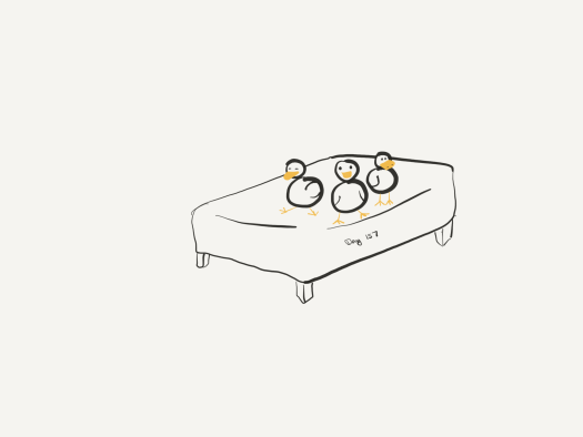 Line drawing of three smug duckens on the bed.