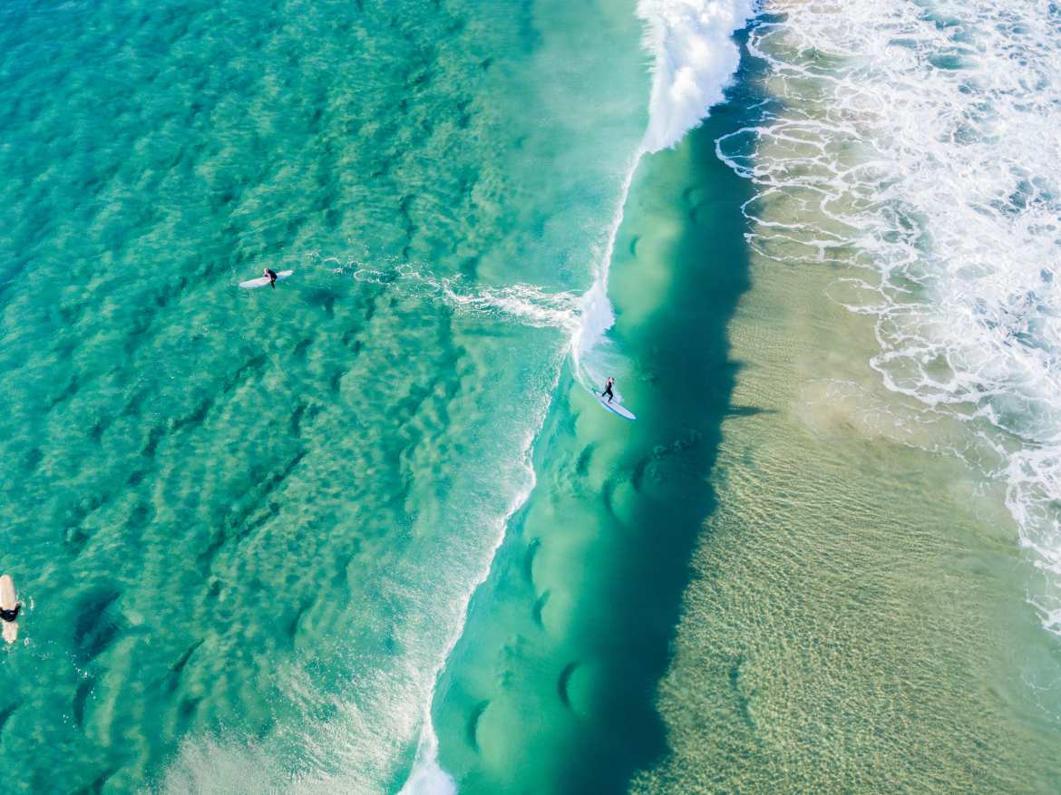 surfers from an aerial view