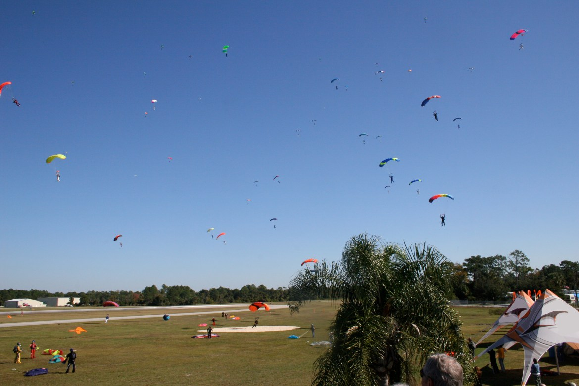 Many people parachuting over Deland