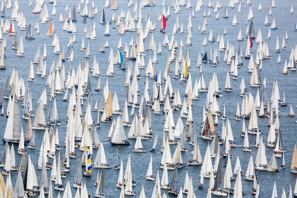 a regatta with a large crowd of sailboats in Barcelona