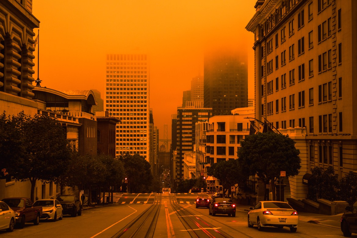 San Francisco, California, USA, September 09, 2020, San Francisco Downtown Wildfire air pollution sky orange yellow glow in the bay area vertical