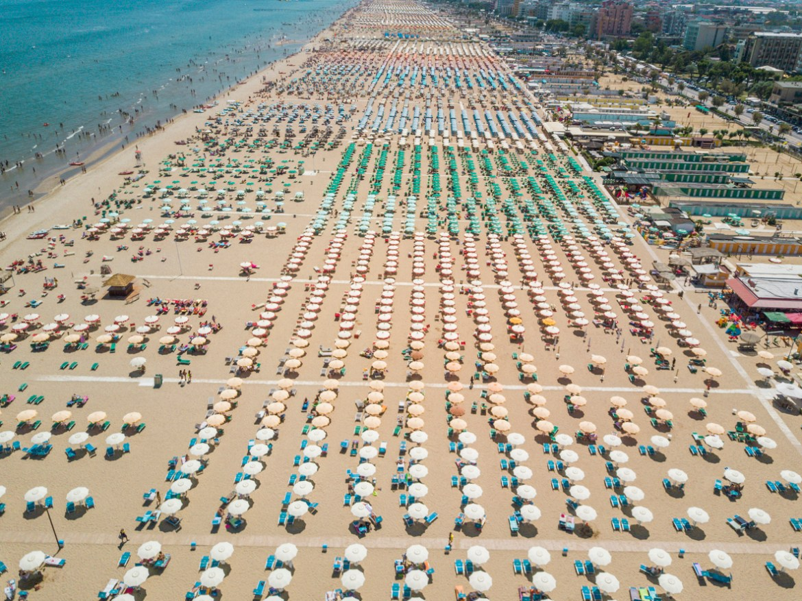 populated, methodically organized beach in Italy as a representation of blockchain