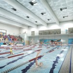 Swimming pool with swimmers in lanes