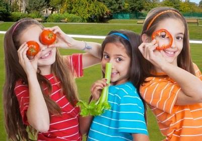 children with fresh vegetables