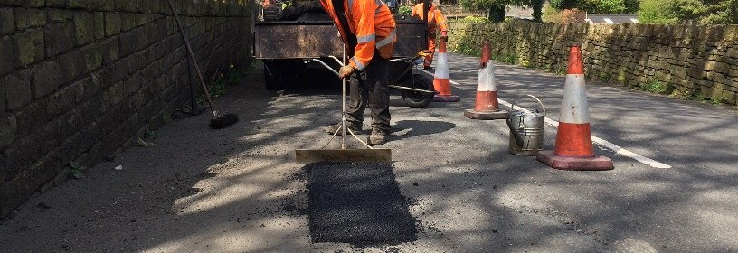 pothole being filled