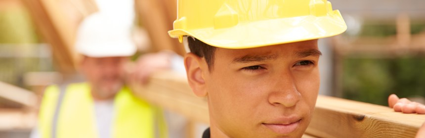 Council Apprenticeship - builder And Apprentice Carrying Wood On Construction Site
