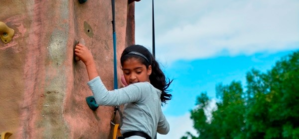 senior school transition day activity - girl on climbing wall