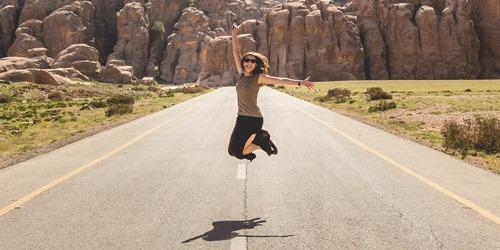 GCSE celebrations - girl jumps for joy