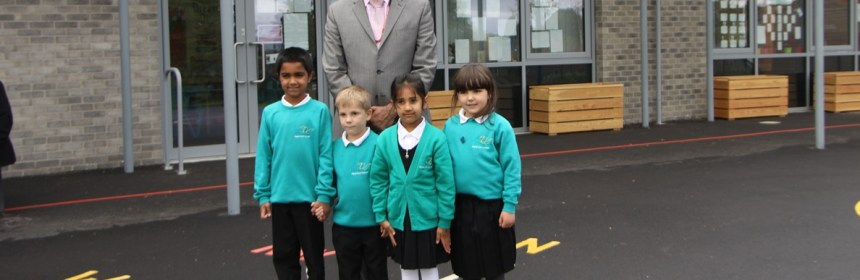 Cllr Masood Ahmed and pupils at new Luck Lane facility at Royds Hall