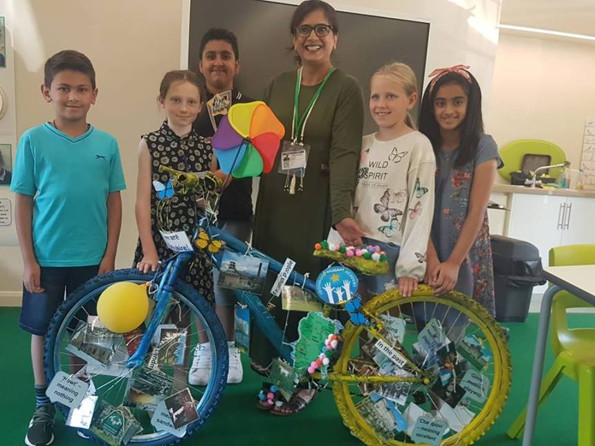 Cllr khan and school council with bike