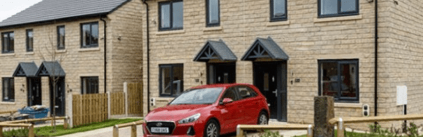 Housing estate with parked cars on the drive