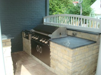 10-Ottawa Hills-BBQ Center-Grill-storage cabinet-side burner-stone island-granite counter-paver