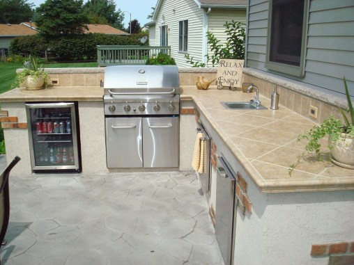 9-Bowling Green-outdoor kitchen-stone counter-Dryvit brick blend-refrig-grill-sink-stainless cabinets