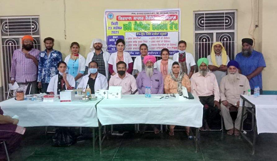 Medical team and local dignitaries