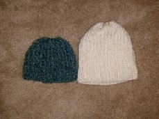 Same blue hat beside a larger, slouchy beanie.