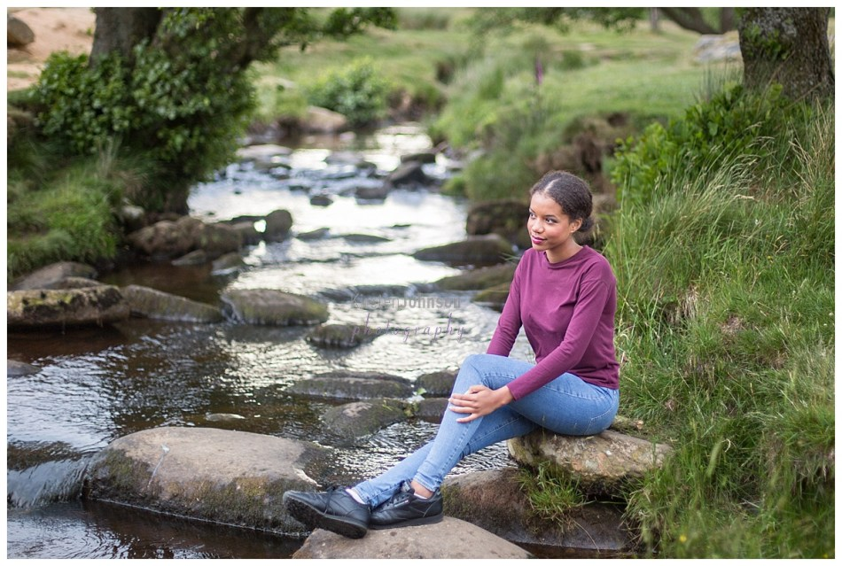 Teenage girl sitting by river