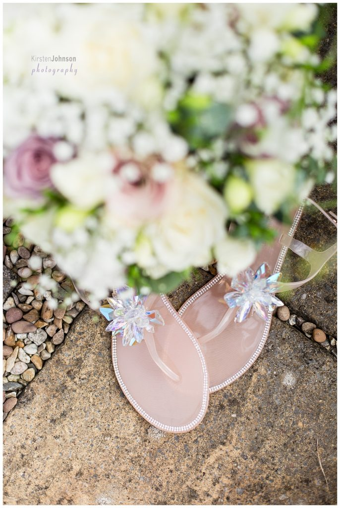 bridal sandals underneath bouquet
