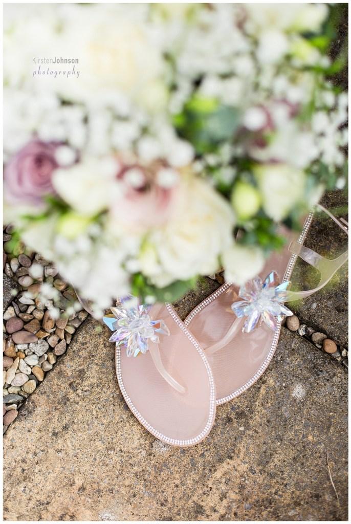 bridal sandals underneath bouquet