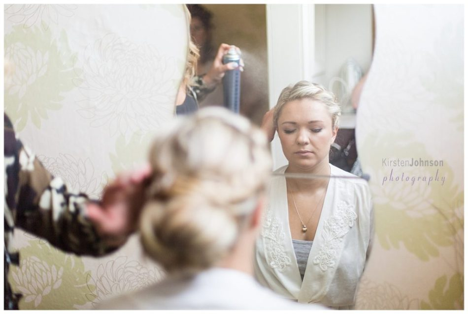 Bride getting hair sprayed