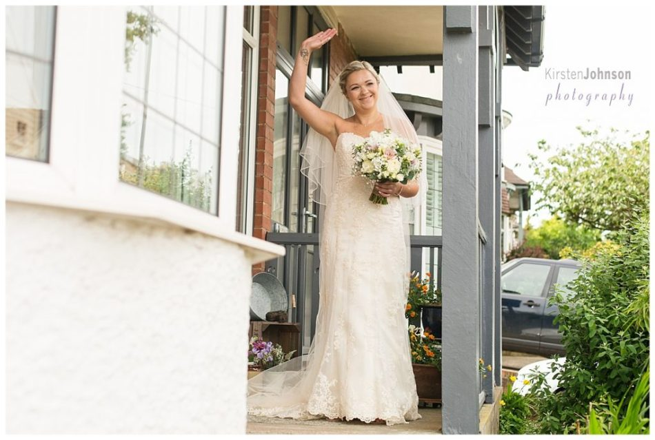 bride waving to passer by