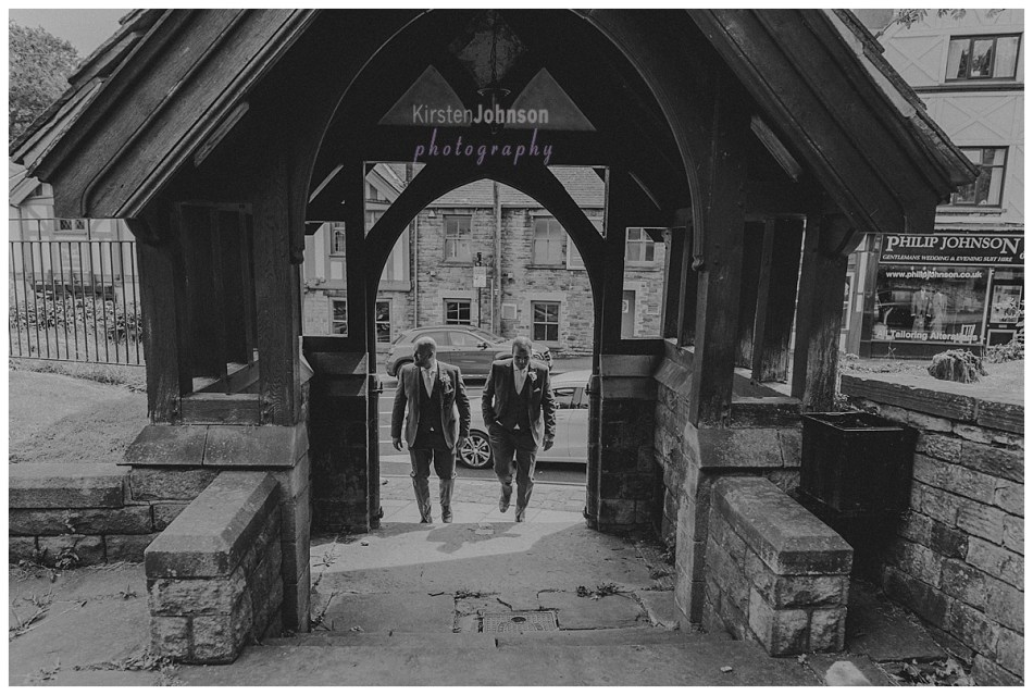 groom and best man walking to church