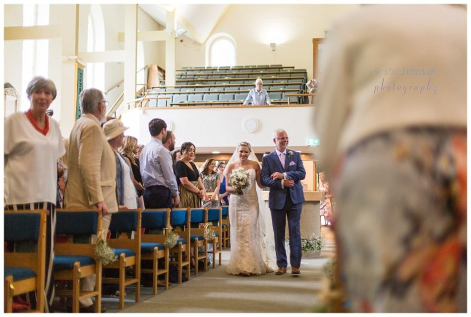 bride with dad walking down aisle