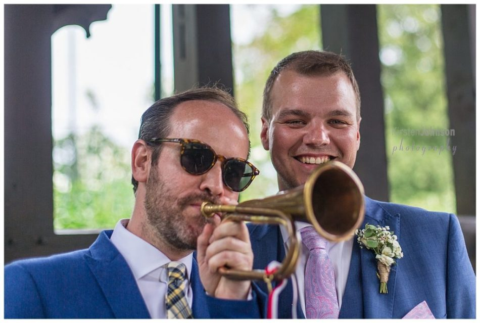 groom with friend and bugle