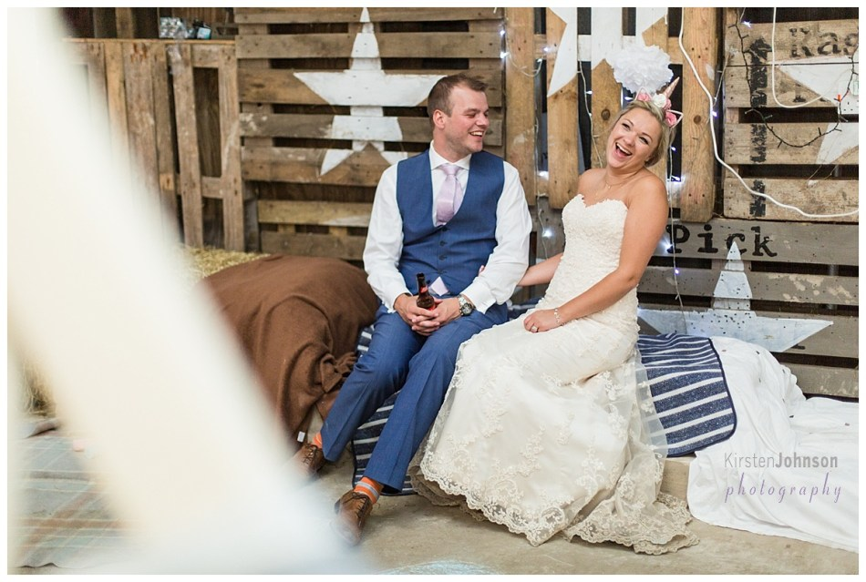 bride and groom laughing at evening reception