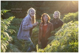 Mum with her 2 teenage daughters in the evening light