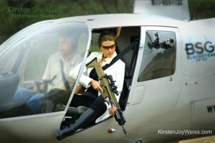 Shooting gun from Helicopter Kirsten Joy Weiss performance shooter