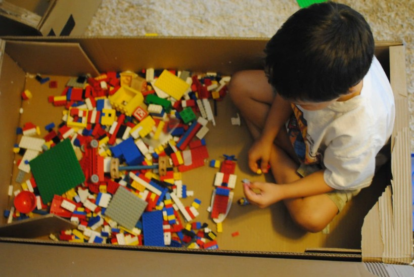 Fun activities for toddlers with a cardboard box.