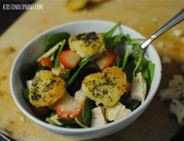 Spring salad, strawberries, blueberries, and heart-shaped croutons. Delicious and tasty!