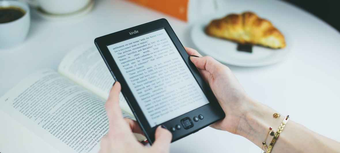 person holding kindle e book reader