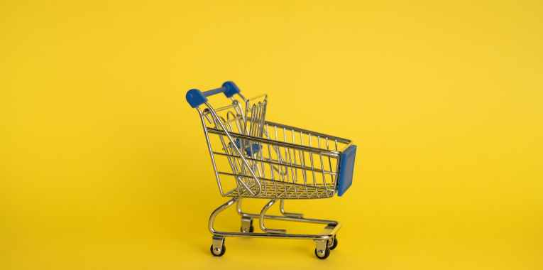 empty shopping cart on yellow background