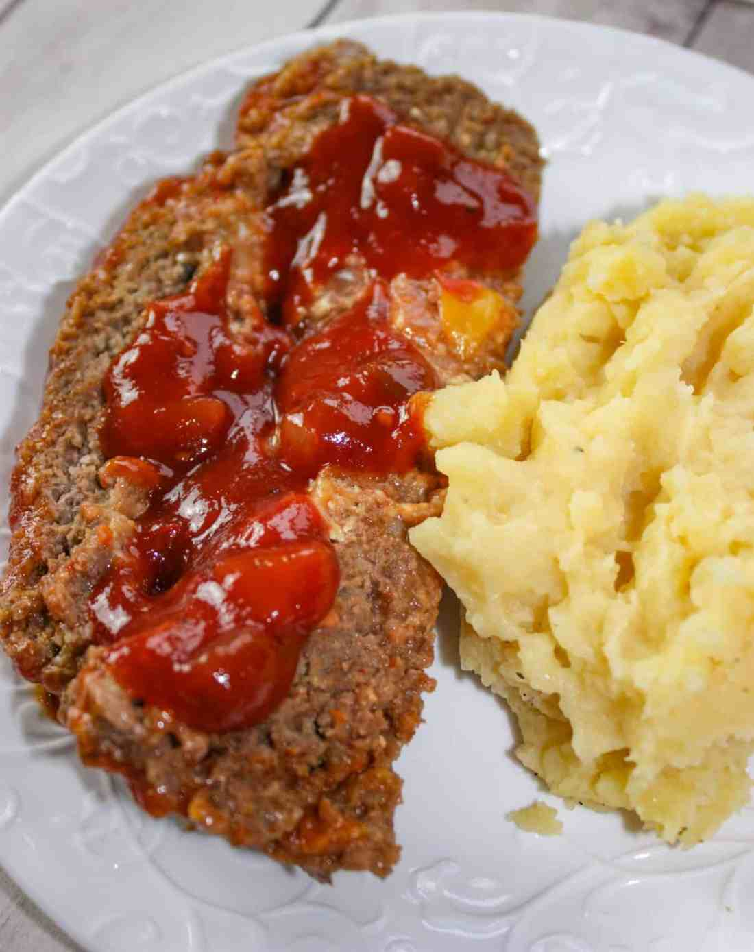 The stuffed meatloaf is moist, full of flavour and paired with a side of garlic mashed potatoes that will satisfy your taste buds.