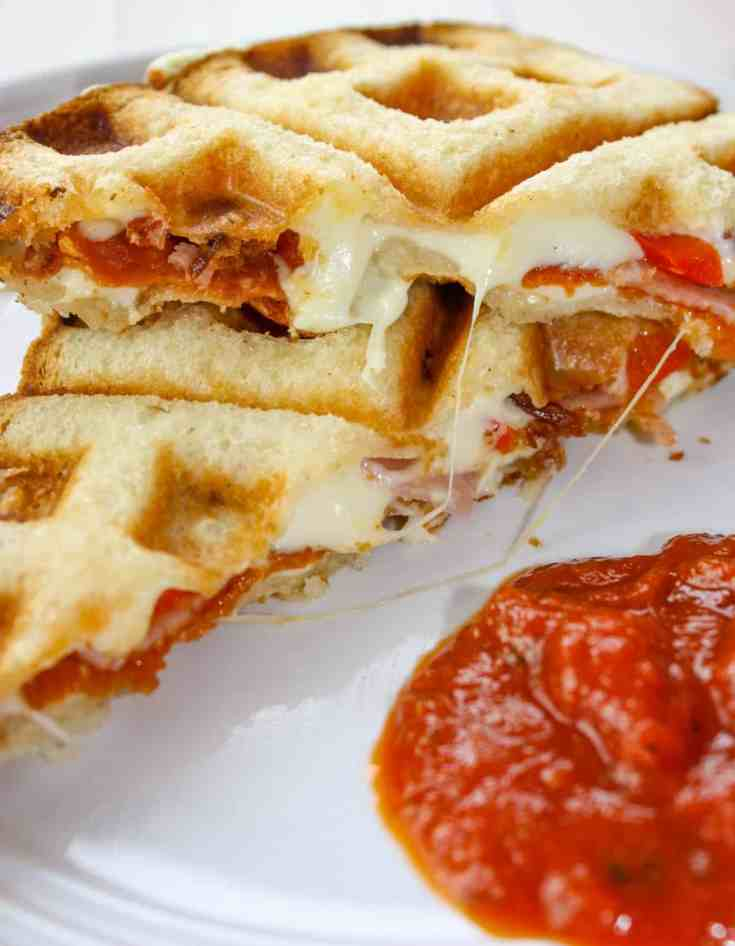 Craving pizza and do not have the time to make gluten free pizza crust from scratch. Solution....Waffled Grilled Pizza Sandwiches!