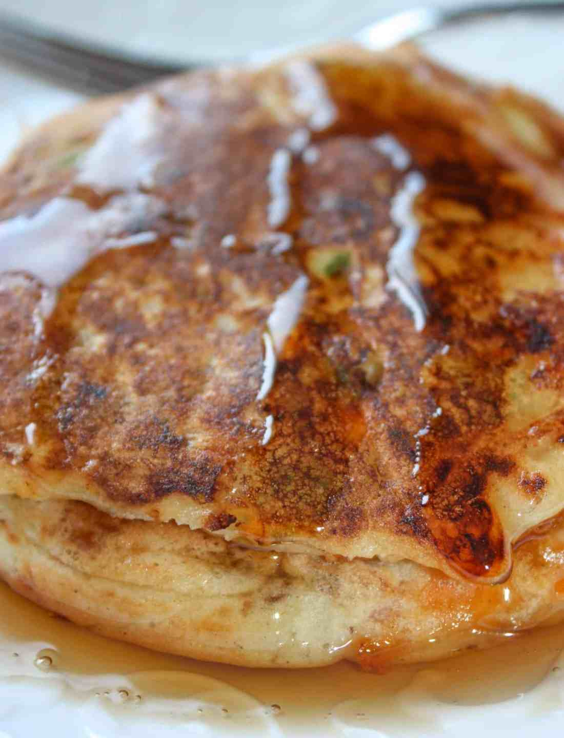 Gluten Free Western Pancakes are a savoury pancake loaded with ham, bacon, onions, green pepper and cheese.  Pour on some sweet, pure maple syrup for a delightful contrast of flavours!