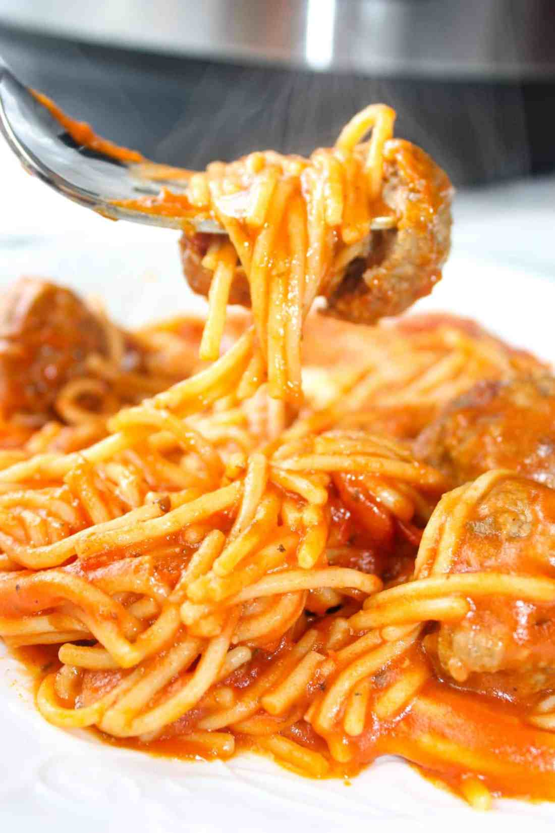 Instant Pot Spaghetti and Meatballs is an easy and delicious pressure cooker pasta recipe.  This family dinner recipe uses gluten free pasta and is loaded with gluten free meatballs and Tomato Basil pasta sauce.