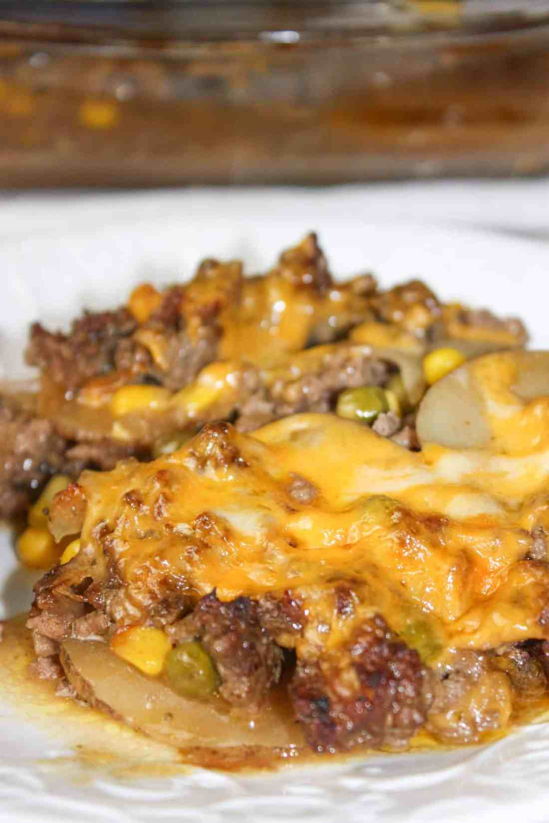 Ground Beef Casserole is a layered dinner recipe that is loaded with potatoes, vegetables and beef.  The gluten free sauce or gravy not only adds moisture but flavour as well.