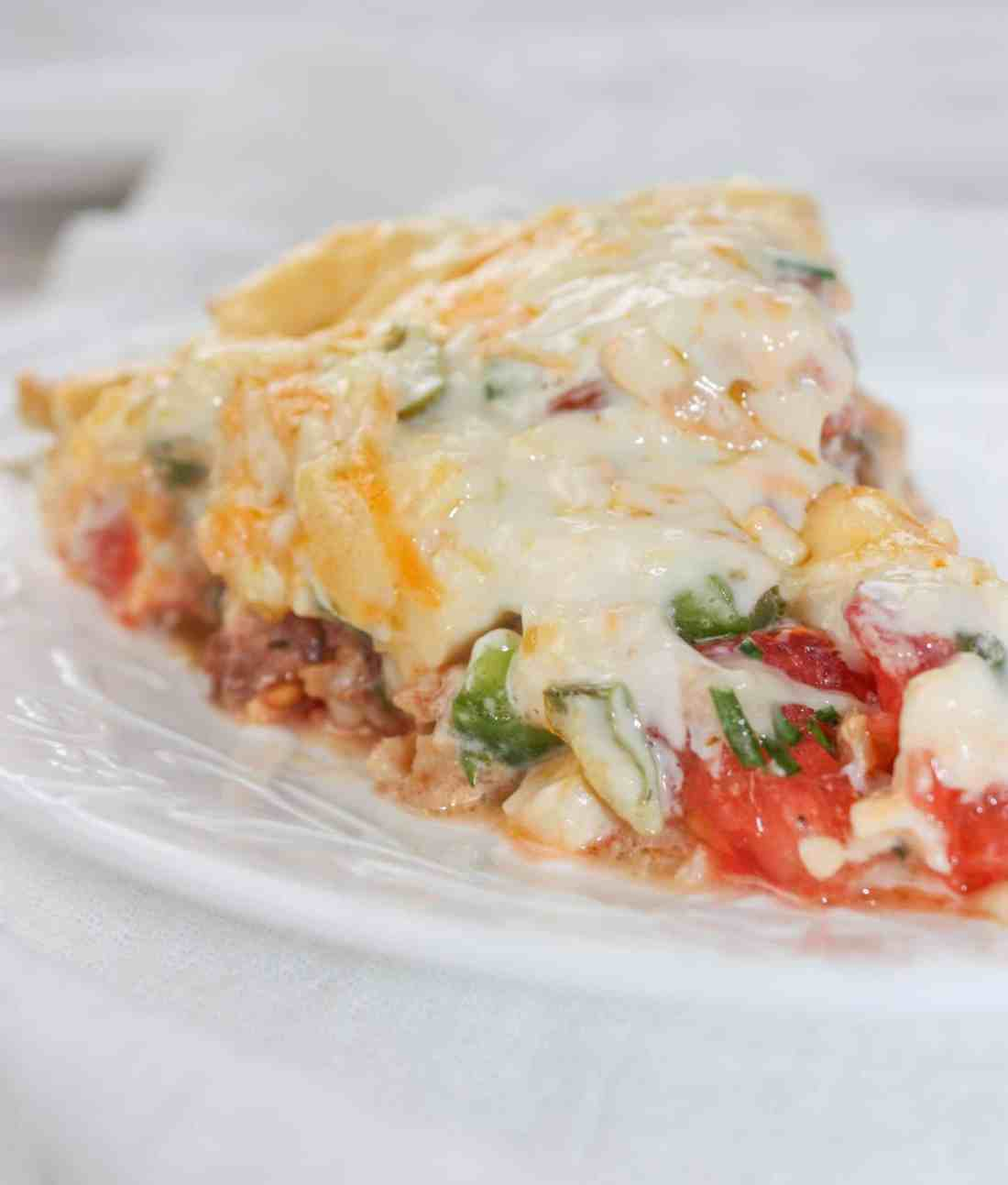 Tomato Pie is a versatile and tasty recipe that can easily be made gluten free with your choice of pie crust. This cheesy, tomato dish can stand alone or complement any main course.