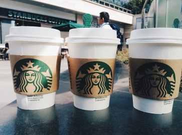 three-white-starbucks-coffee-cups