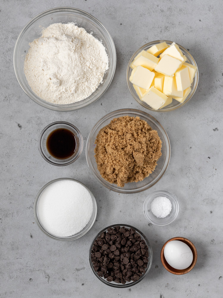 All of the ingredients you need for brown butter blondies! flour, butter, vanilla, brown sugar, granulated sugar, salt, eggs, and chocolate chips