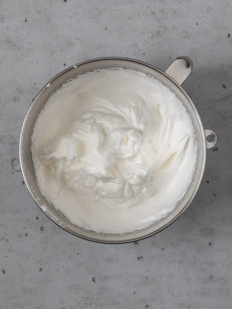 Meringue beat to stiff peaks in a bowl.