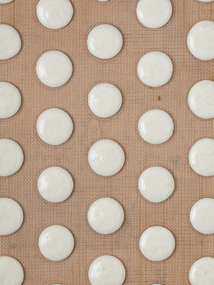 Macarons piped into 1-inch circles