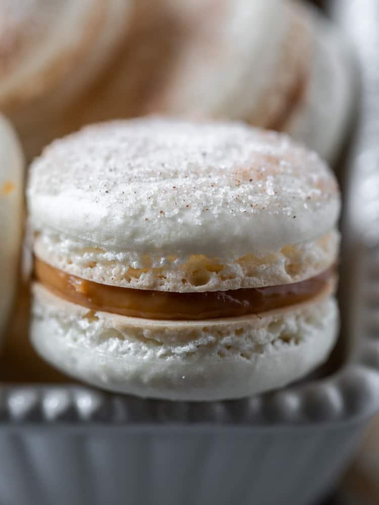 A close up of a churro macaron in a dish